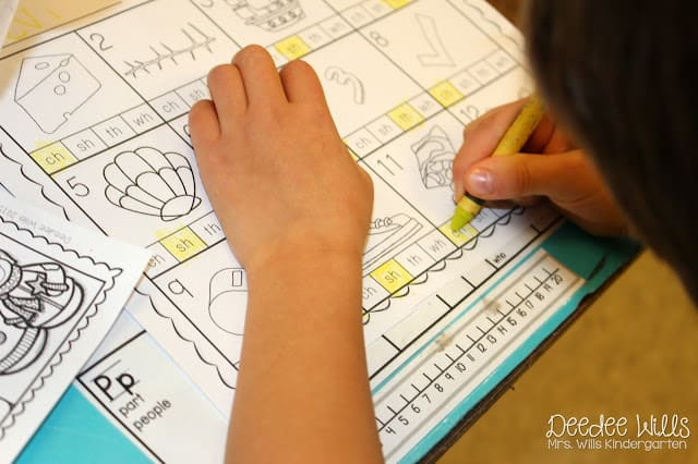 Kindergarten Math and Literacy Worksheets. Check out these kindergarten center ideas for winter! Perfect for the month of January! Skills include: vowels, sentence writing, subtraction, and addition!