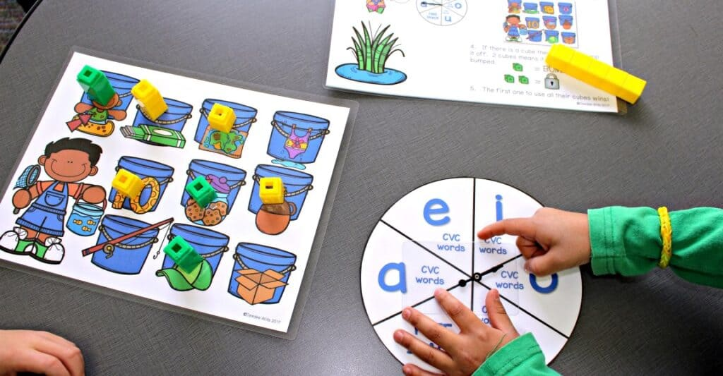 Teach these simple kindergarten classroom games and swap out the skills to have a predictable center or station all year long! Check out the first-grade games, too!